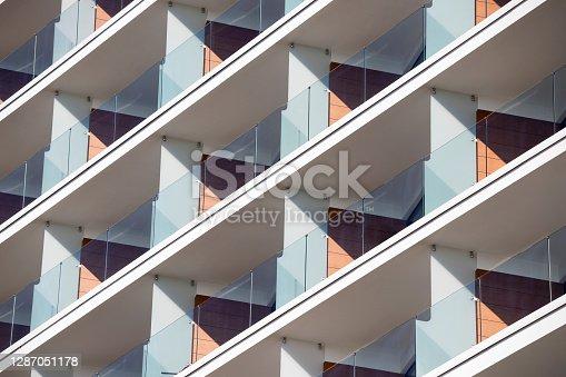 istock Balconies in modern apartment building 1287051178