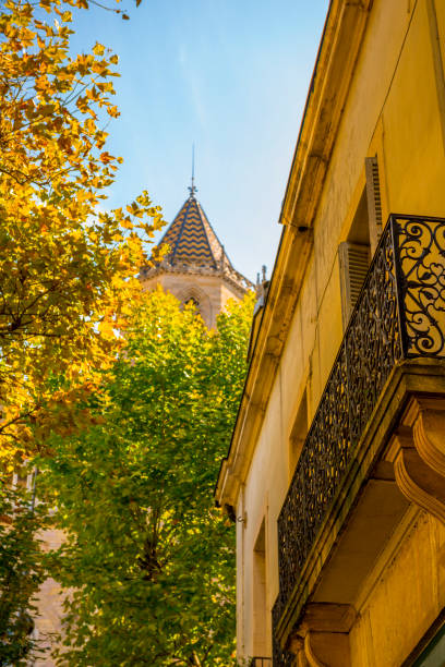 Balcony and a Tower with Autumn Tree stock photo