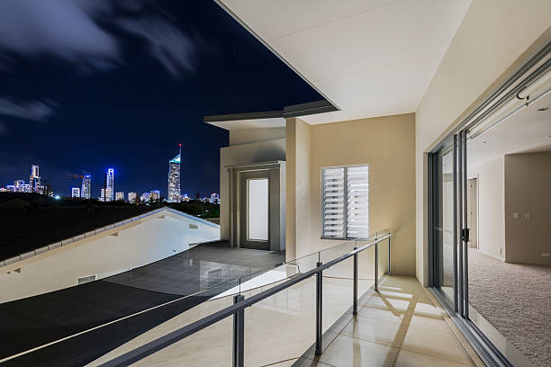 Balcony exterior of mansion with night views of skyline stock photo
