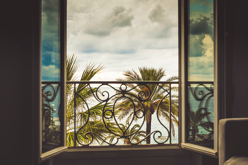 Balcony frame with the Mediterranean sea blurred in the background