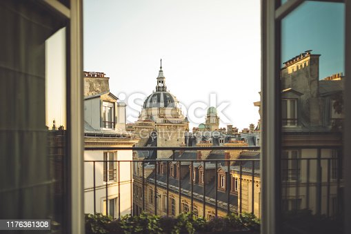 Balcony frame with the University of Paris blurred in the background