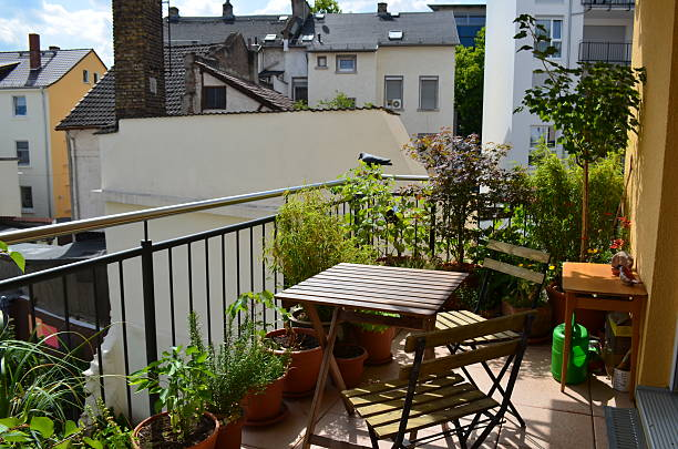 Balcony garden, tables and chairs: spring / summer stock photo