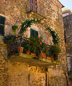 A balcony in an historic stone residential building in the village of Montemerano near Manciano in Grosseto province, Tuscany, Italy