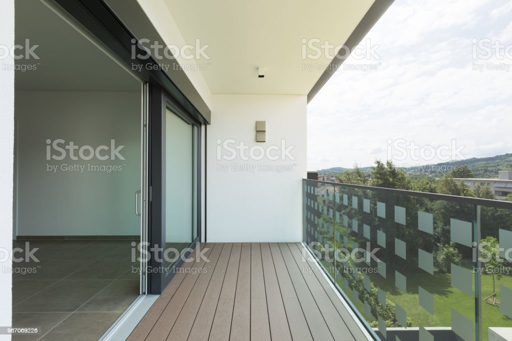 Balcony of new house with white walls, landscape view stock photo