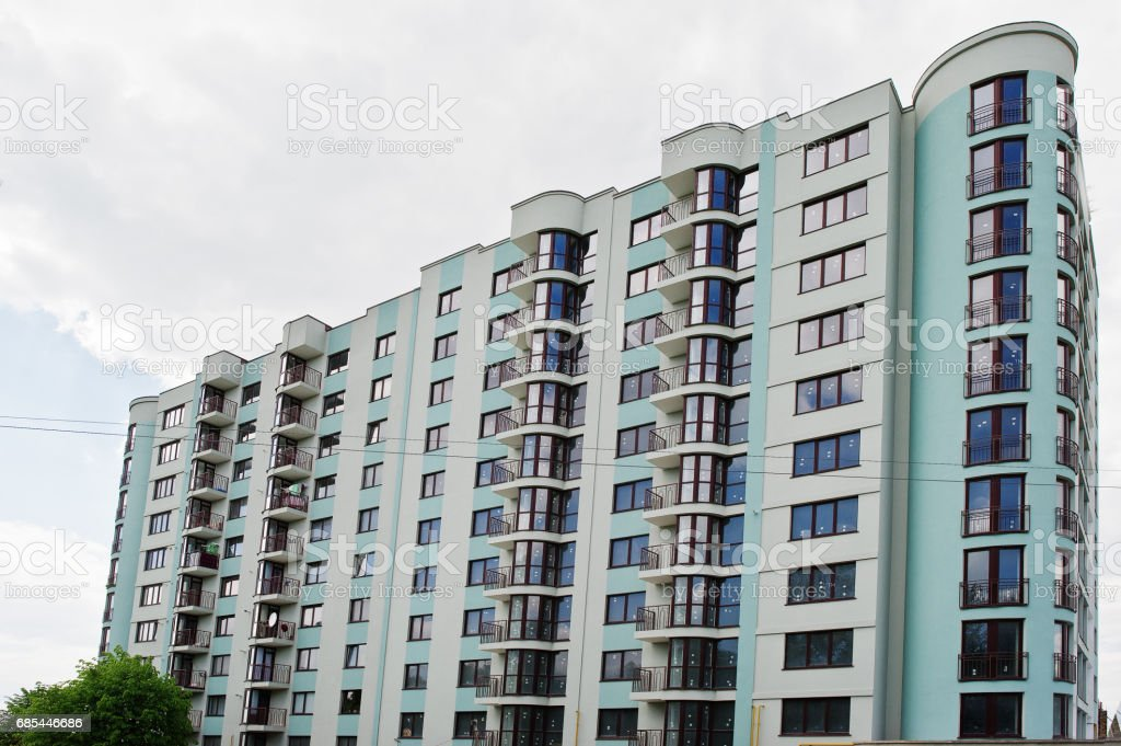 Balcony of new modern turquoise multi storey residential building house in residential area on sunny blue sky. foto de stock royalty-free