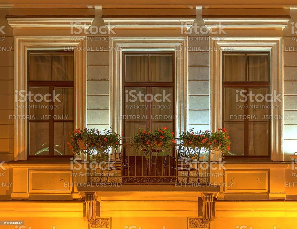 Balcony on night facade of Kempinski Hotel Moika 22 stock photo