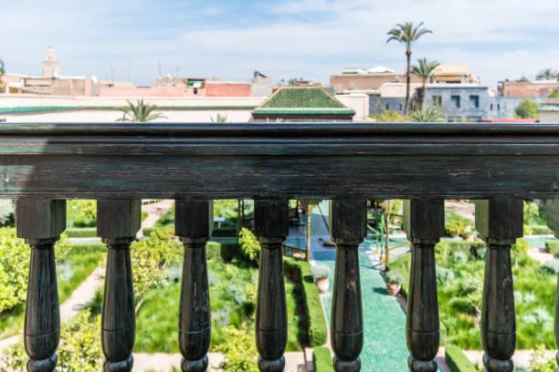 Balcony over a garden in Marrakesh, Morocco stock photo