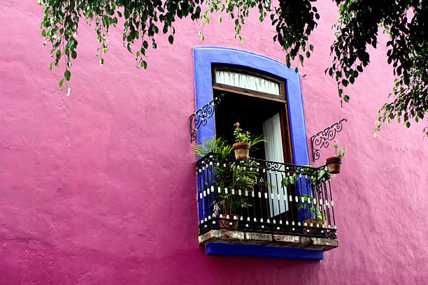 Balcony Blue balcony on a pink wall in Puebla, Mexico puebla state stock pictures, royalty-free photos & images