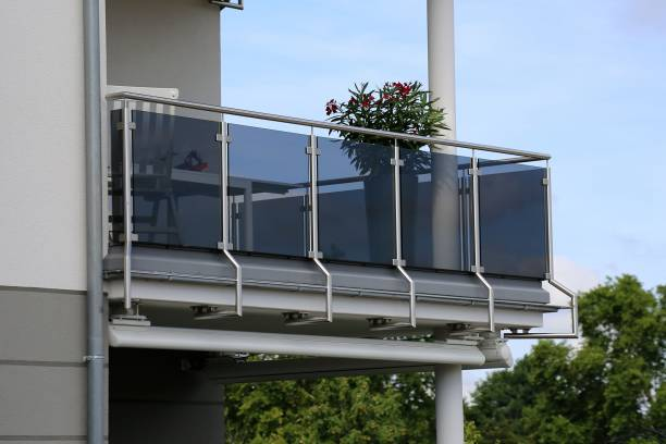 Balcony railing with glass and stainless steel stock photo