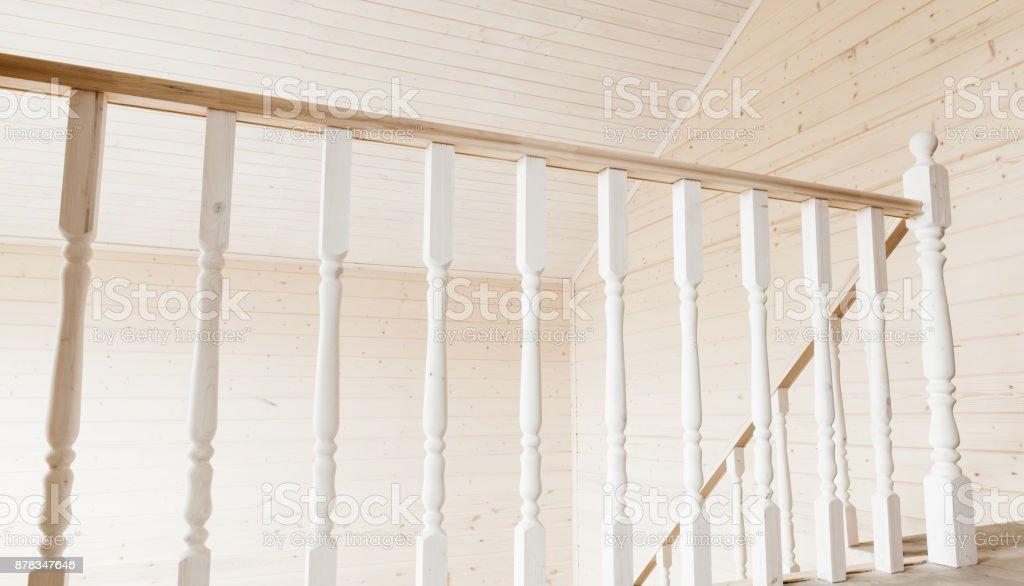 Balcony railings. Empty wooden house interior stock photo