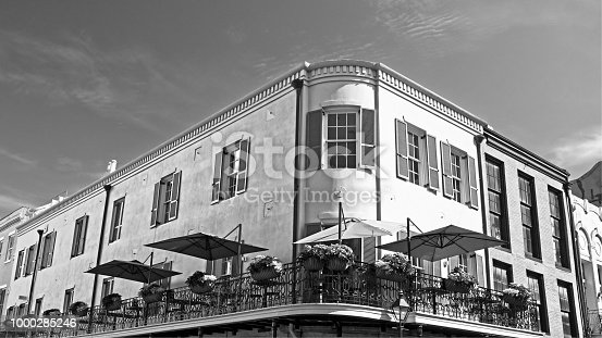 New Orleans, LA USA - May 9, 2018  -  Balcony with 12 Flower Planters in The French Quarter in B&W