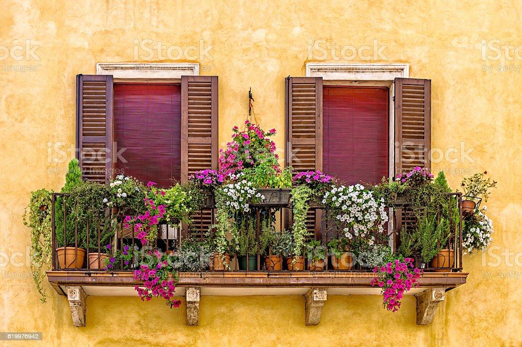 Balcony with flowers in Verona stock photo