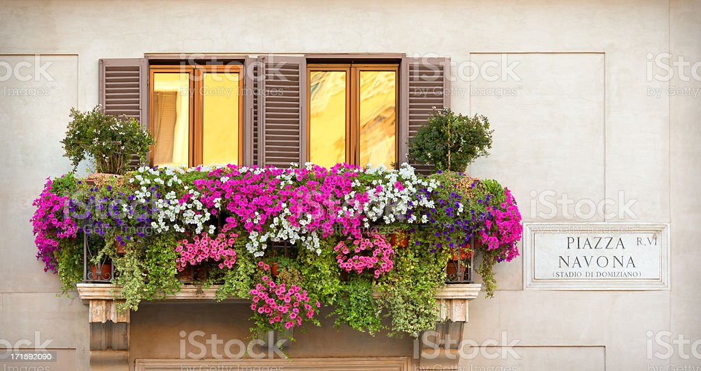 A balcony with multicolored flowers stock photo