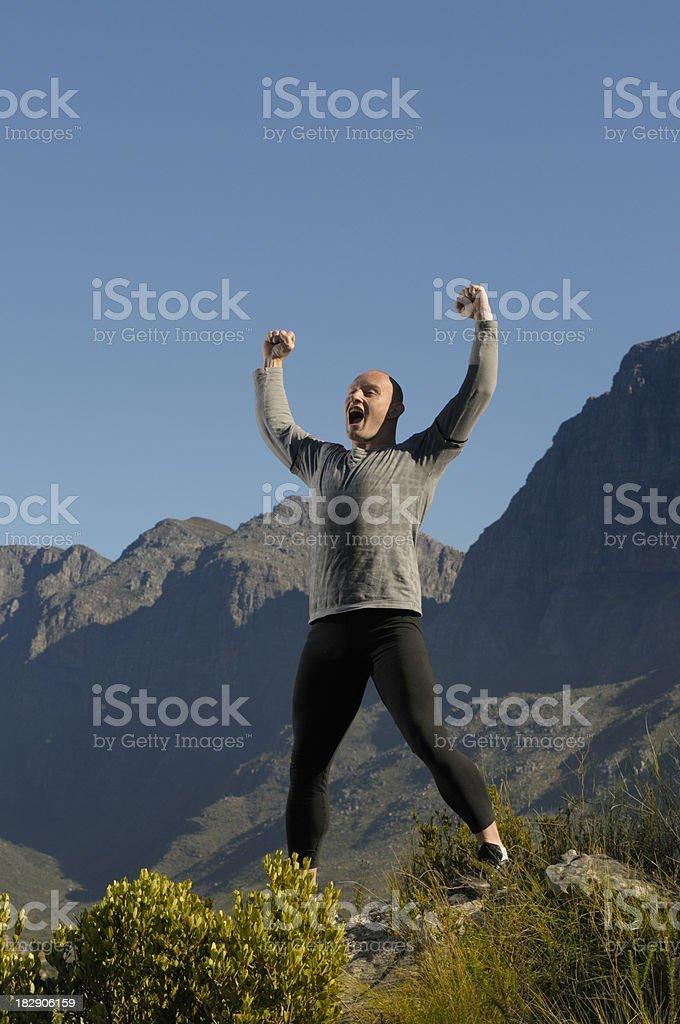 Bald athlete on rock level stock photo
