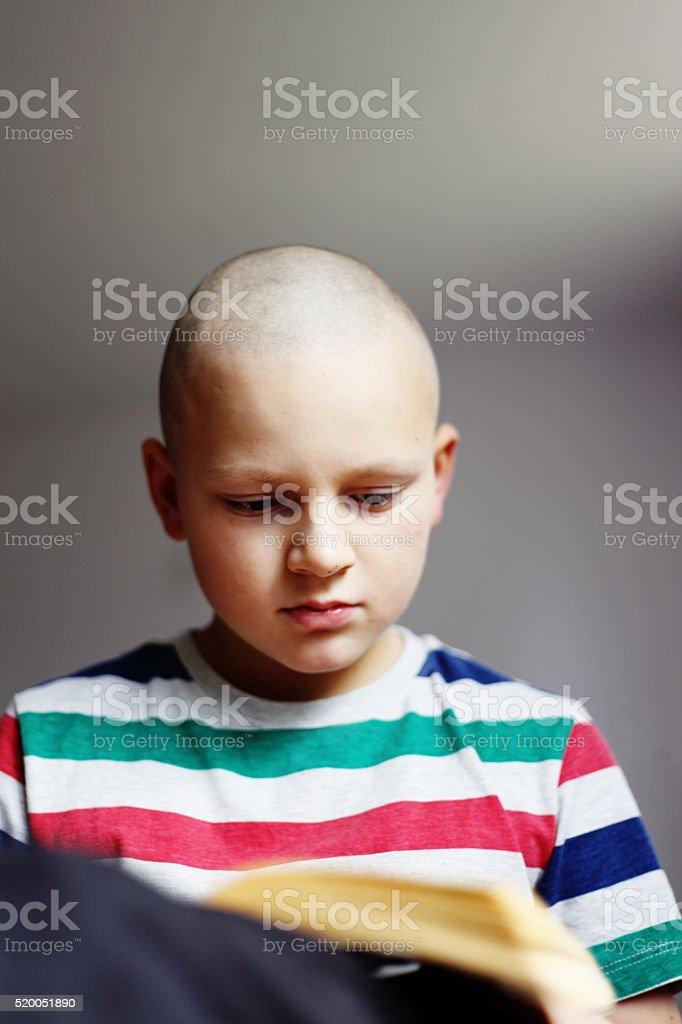 bald boy stock photo