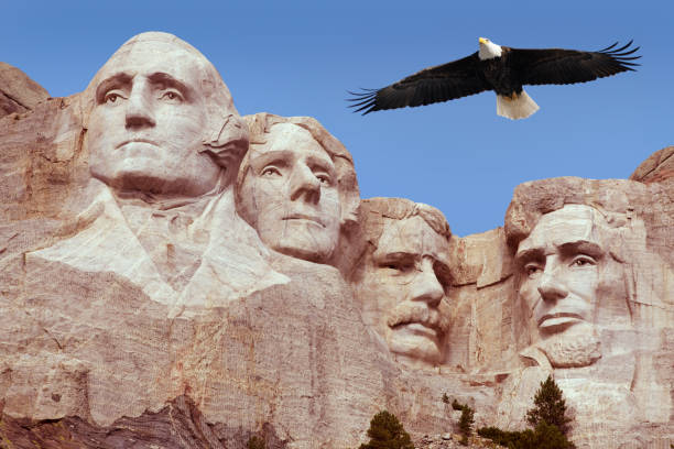 Bald Eagle Flying Free Above American Monument Mount Rushmore Presidents  mount rushmore stock pictures, royalty-free photos & images