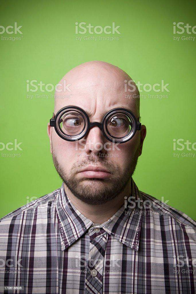 Bald Geek on Green - Cross Eyed royalty-free stock photo