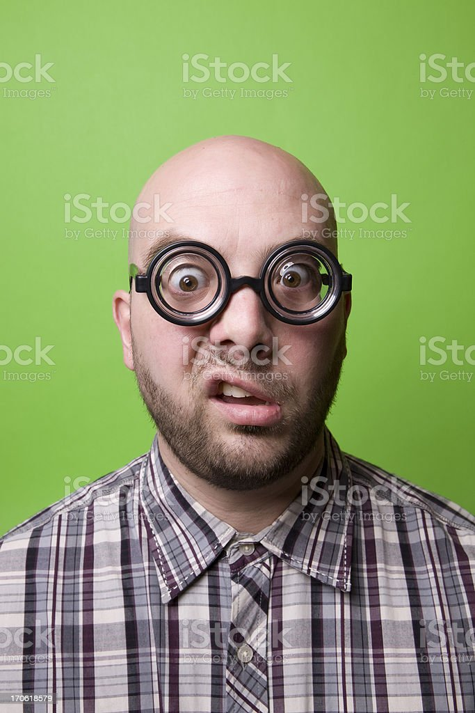 Bald Geek on Green - Disgusted royalty-free stock photo