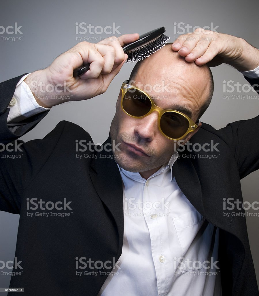 Bald Guy is combing stock photo