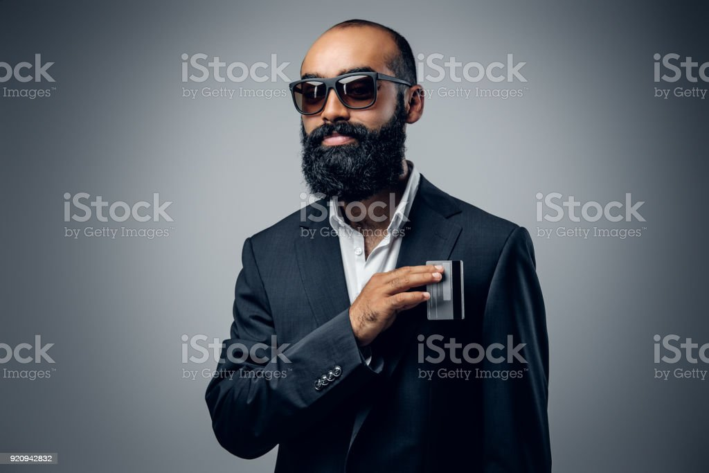 Bald head male dressed in a suit and sunglasses. stock photo