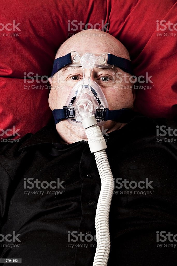 Bald man awake with cpap mask royalty-free stock photo