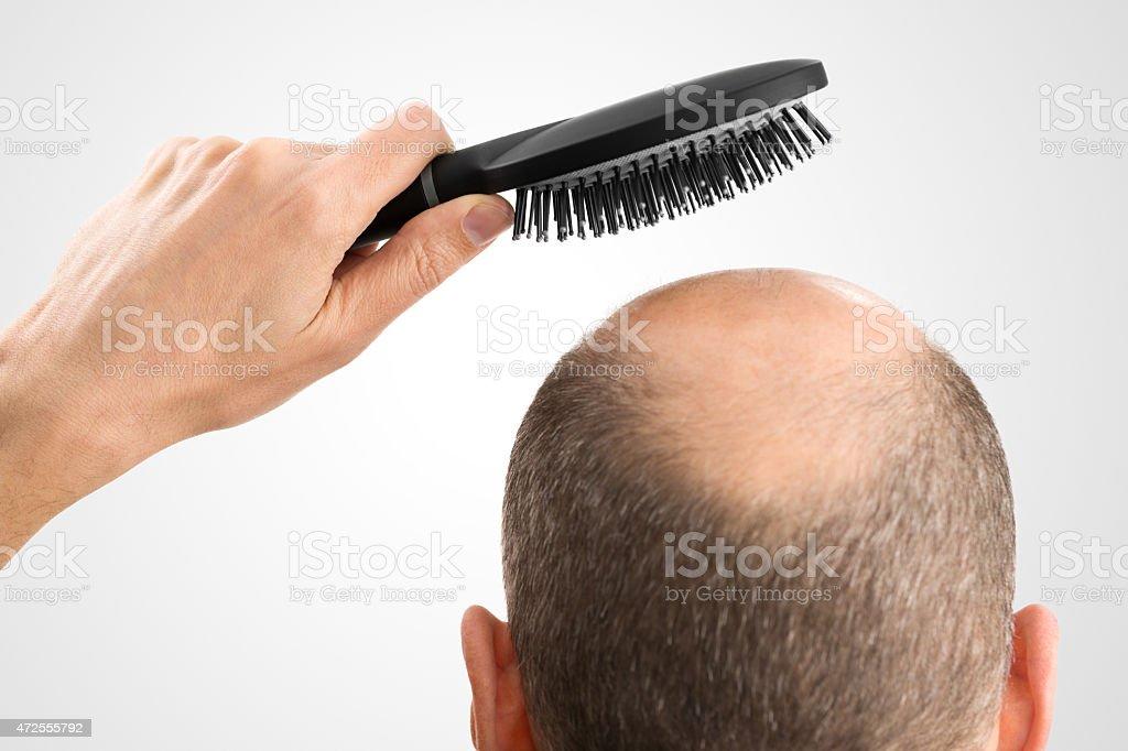 Bald man with brush stock photo