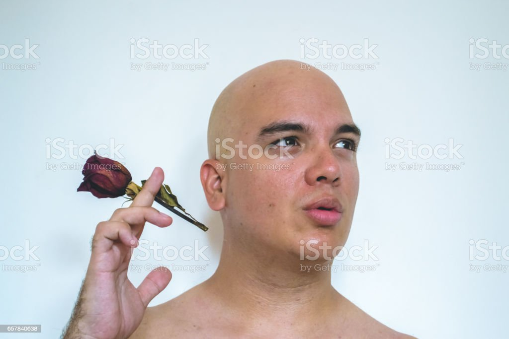 Bald man with red old roses stock photo