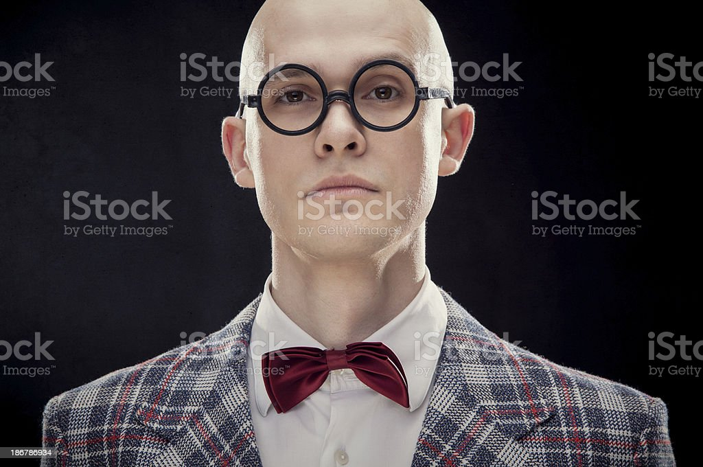 Bald professor with bow tie and rounded glasses black isolated royalty-free stock photo