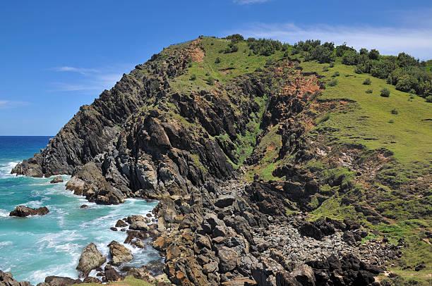 Bald rocky headland at Byron Bay, Australia stock photo