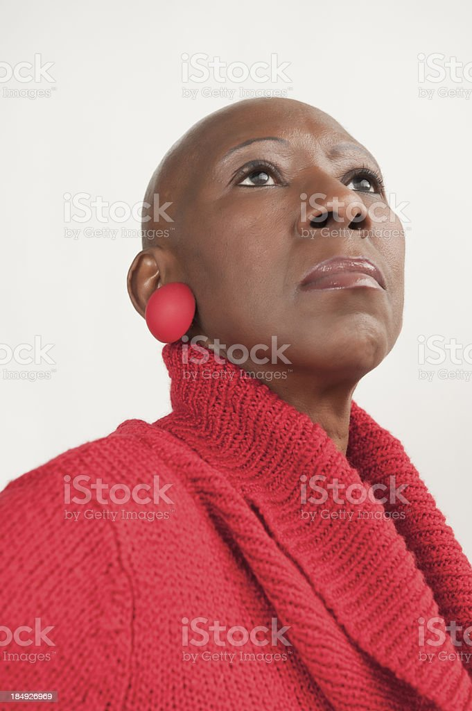 Bald Senior African American Woman Stands Proudly After Chemotherapy stock photo
