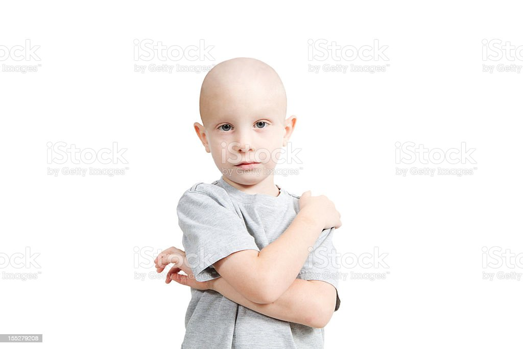 Bald small child in white shirt on white background stock photo