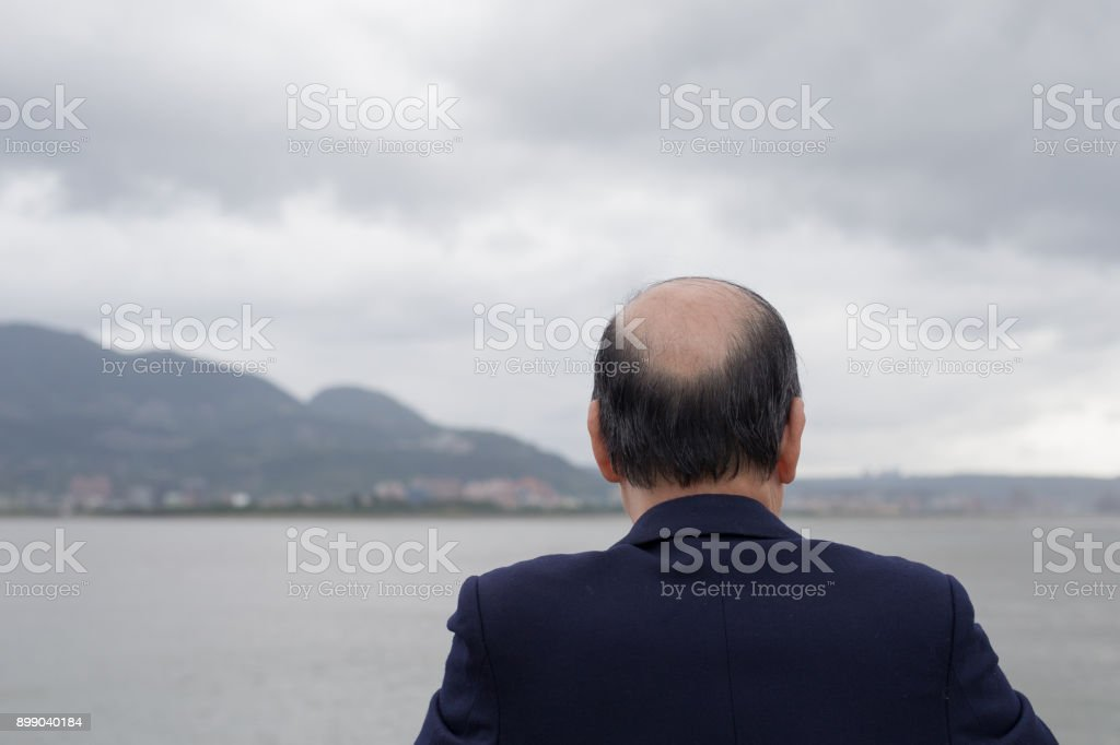 Baldness old man look somewhere stock photo