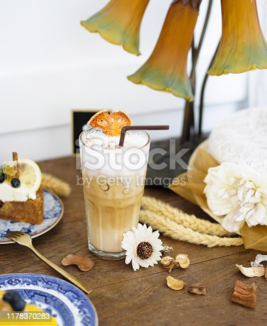 Bale latte. Bale is species of a plant native to South East Asia. Bale is known by many names such as Aegle marmelos and Bengal quince. Iced coffee with Aegle marmelos, special drink. Soft focus and rustic style