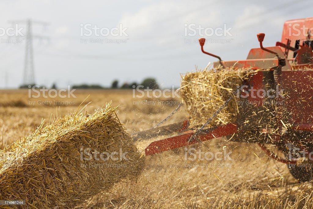 Baler making straw bales royalty-free stock photo