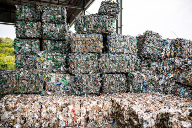 Bales of Compressed Recyclable Materials Stacked Outdoors stock photo