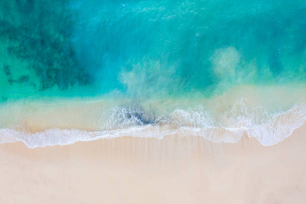 Bali, aerial view of a beach - blue transparent ocean and white sand. stock photo