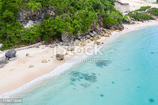 931756010 istock photo Bali. Beach scene from above - colourful beach umbrellas and blue transparent ocean. 1159773040