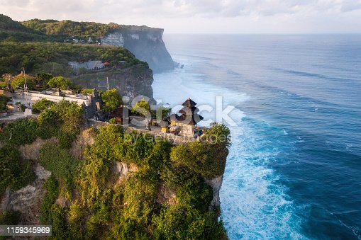 Bali, Indonesia, aerial view of Pura Luhur Uluwatu temple at sunrise.