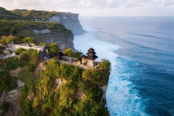 Bali, Indonesia, Aerial View of Uluwatu Temple at Sunrise Bali, Indonesia, aerial view of Pura Luhur Uluwatu temple at sunrise. indonesia stock pictures, royalty-free photos & images