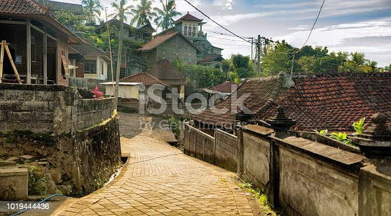 Bali Indonesia small mountainside village street lined with traditional houses