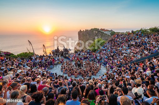 Bali, Indonesia - June 24, 2019: Traditional Kecak Fire Dance performance at Uluwatu Temple at sunset in Bali, Indonesia.