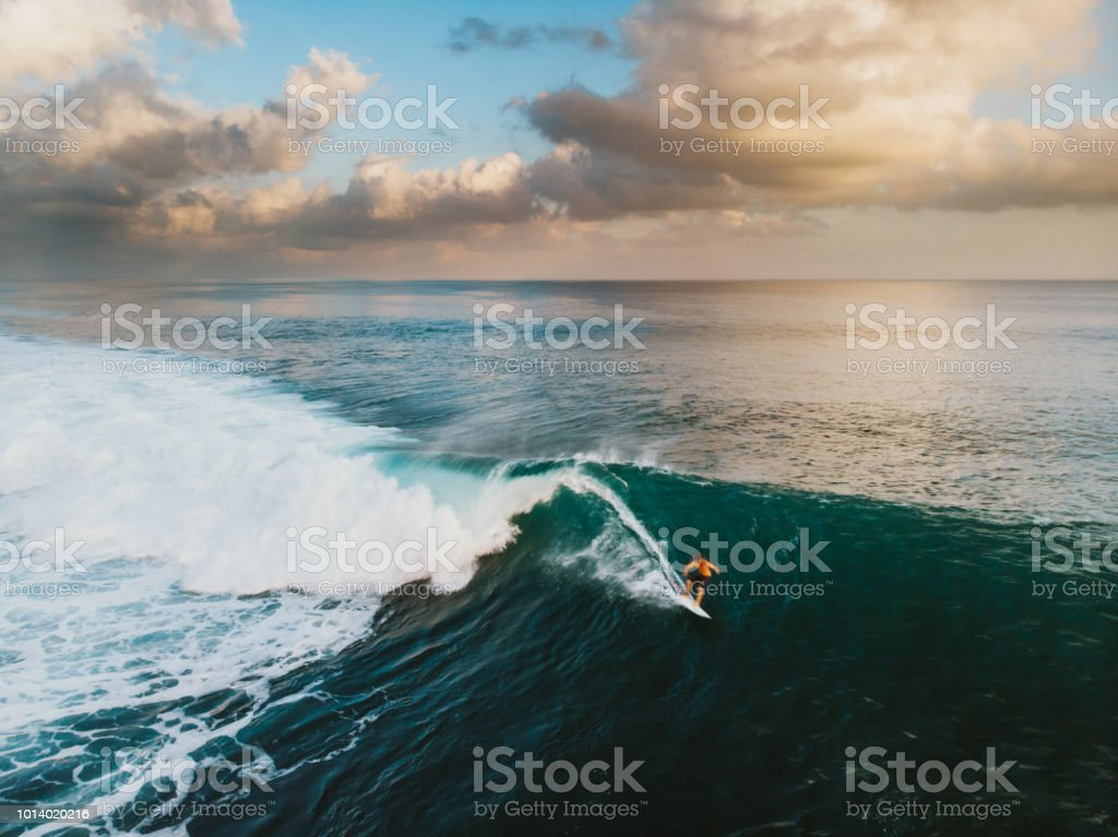 Bali Surf Zone Surfer Riding a Wave stock photo