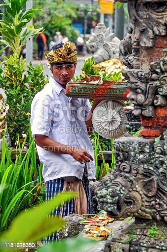 Indonesia. Bali. Ubud. May 27, 2010. Man making traditional morning offering