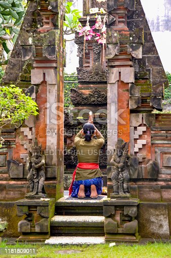 Indonesia. Bali. Central Region. Ubud. May 26, 2010. Woman praying at a temple