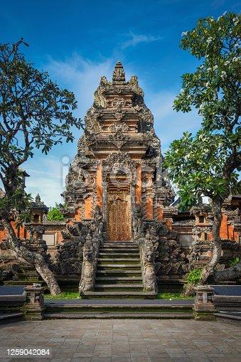 Majestic Ubud Water Palace. Stairway to Hindu Pura Taman Kemuda Saraswati Temple in Ubud under blue summer sky, Ubud, Bali Island, Indonesia, South-East Asia, Asia.