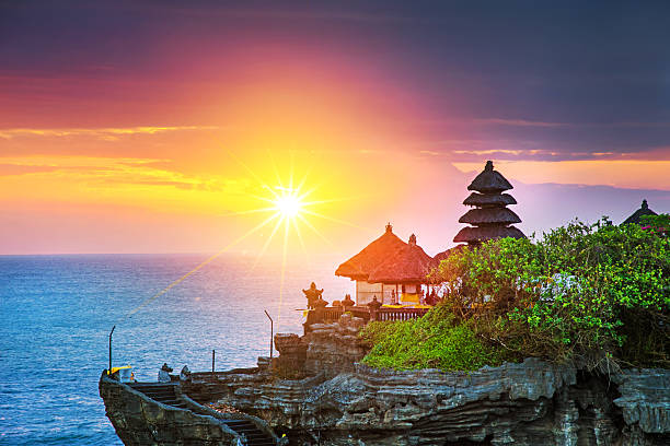 bali water temple - tanah lot - indonesia stock photos and pictures