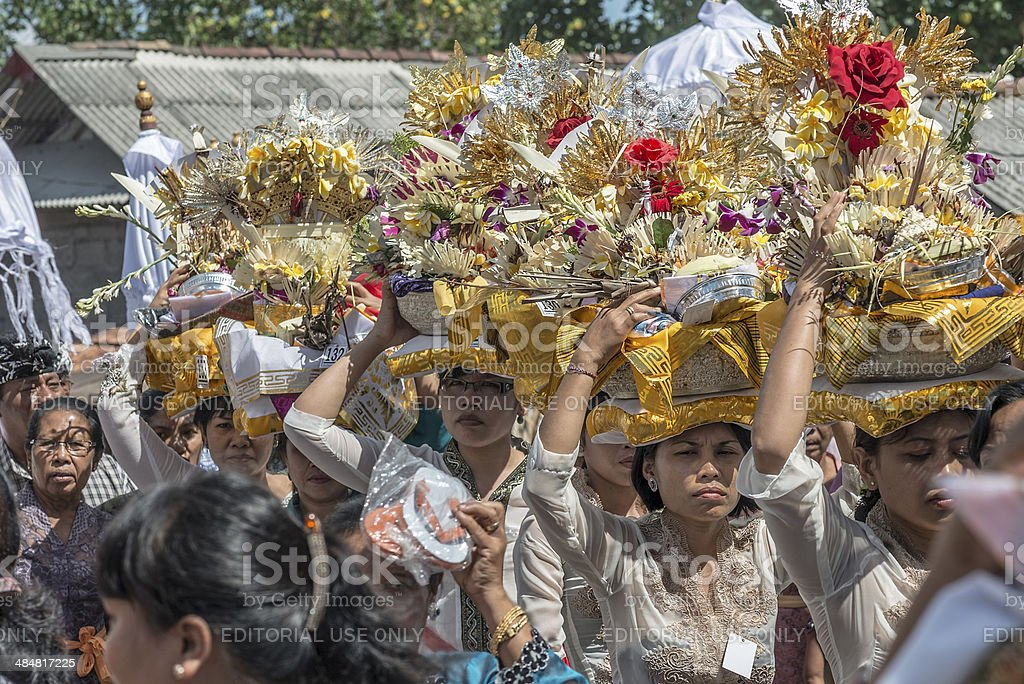 Bali Women Line up with Floral Offerings stock photo