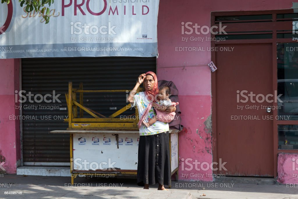 Baliindonesia August 302012a Young Woman With A Baby In Her Arms