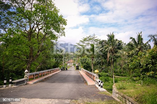 Balinese Bridge in small village. This bridge is located in a small mountain village near Siedemen. It connects one mountain side from mount Agung to the village
