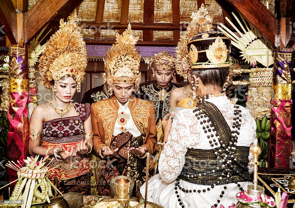 Balinese couple getting blessed for their wedding in Bali stock photo